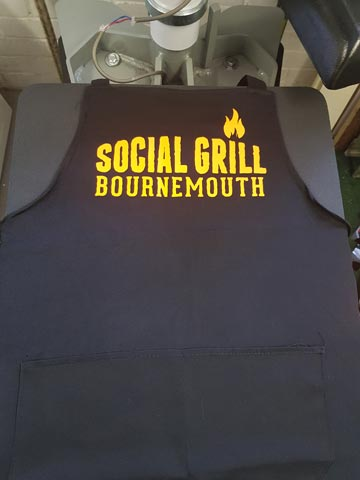 Social Grill Bournemouth, bbq, food, catering, apron, pocket, neon, orange, vinyl, transfer, heat press, printed, t-shirt printing, Bournemouth, Poole, Dorset, text